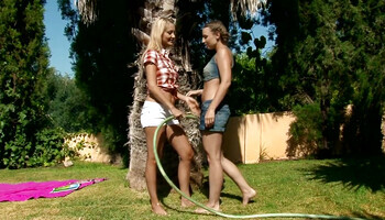 Sweet girlfriends are messing around in the garden