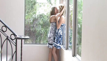 Lesbian girlfriends are making love by the window