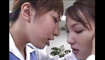 Japanese schoolgirls are passionately kissing and fondling