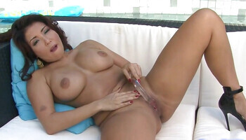 Smoking hot Asian MILF plays with a glass dildo