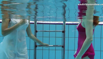 Chicks are filmed with underwater camera in the swimming pool