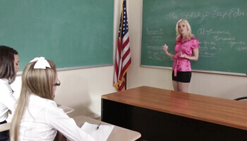 Blonde teacher is lured into a lesbian threesomne by schoolgirls