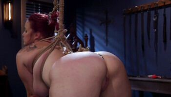 Bound redhead is strap-on fucked by black mistress