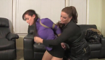MILF is bound by her mistress in inescapable hog tie